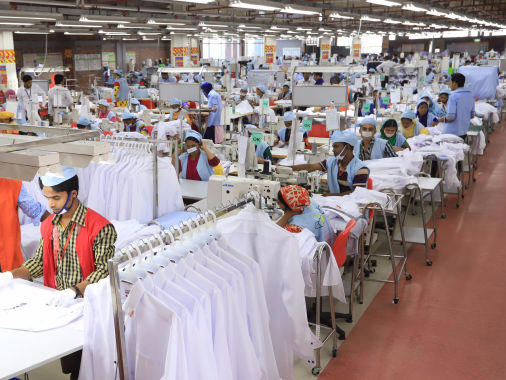 workers-in-a-garments-factory-in-bangladesh.-676x380